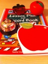 Lesson plan book, magnetic apple clip, apple stress ball, school bell, and apple notepad